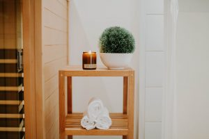 shelf with candle and towels